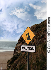 beach landslide caution sign - a landslide sign in county...