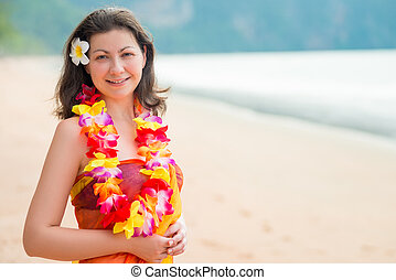 Horizontal portrait of a woman on the beach in floral...