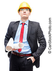 Portrait of an experienced architect in a yellow helmet on the head posing on a white background