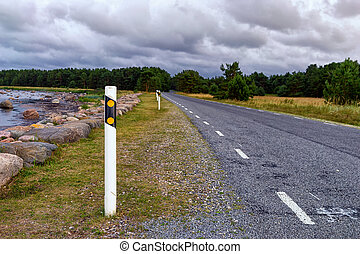 The road to northern Europe - Road sign on an asphalt road...