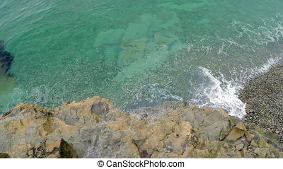 Sea surf with turquoise water, top view