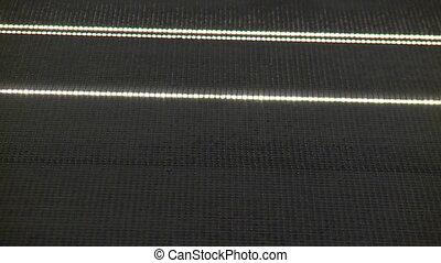 Blinking laser lights installation closeup. Handheld shot.