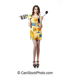 housewife tries a soup. woman in an apron with a saucepan....