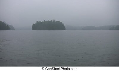 Misty rainy islands 2 shots - A light rain falls on the lake...