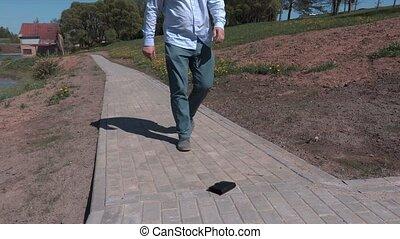 Man find wallet with cash on sidewalk