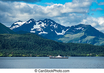 View to the Storfjord in Norway with ferry.