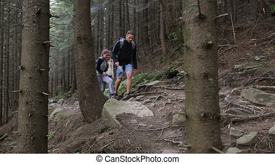 Hiking people. Hiker trio in the mountain. Two woman and man...
