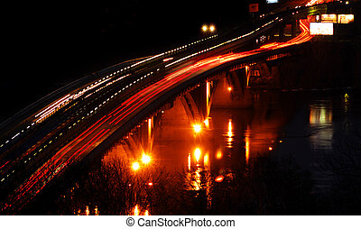 Night traffic on the bridge - Night cityscape with a...