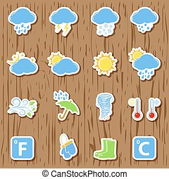 Weather stickers on wooden background