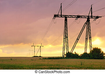 Electric power pylons at sunset