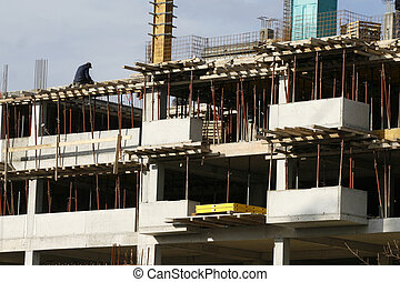 construction new - construction worker working on a...