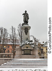 Monument of Polish poet Adam Mickiewicz in Warsaw, Poland. -...