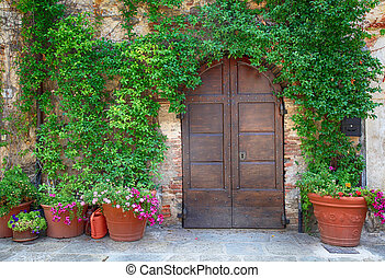 Beautiful old wooden door decorated with flowers, Italy -...