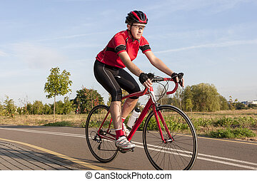 Cycling Concepts and Ideas. Male Caucasian Road Cyclist...