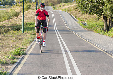Cycling Ideas. Portrait of Professional Male Cyclist Doing...