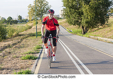 Sport and Cycling Ideas. Portrait of Professional Male...