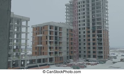 Apartments construction site with crane. Crane and building...