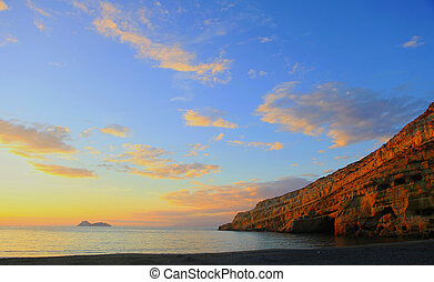 Matala beach sunset - Sunset over Matala beach, Crete, with...