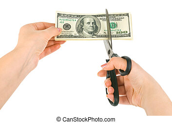 Hands with scissors cutting money isolated on white...