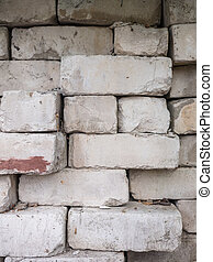 White calcium silicate bricks piled on top of each other....