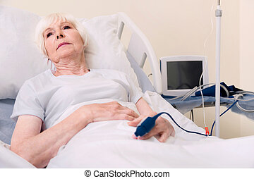 Sad fragile aged woman getting better after disease - Many...