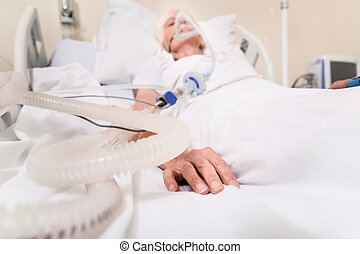 Unconscious sick woman recovering from serious lung disease...