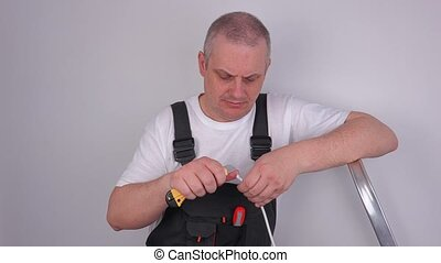 Worker with knife and cable