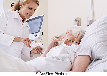 Brilliant sweet doctor giving her patient new instructions -...