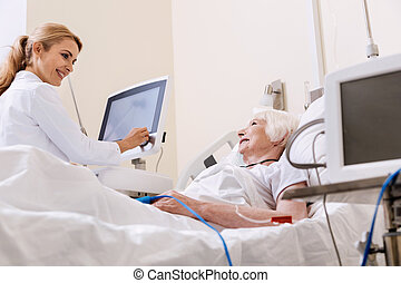 Sweet qualified doctor talking to her bright patient -...