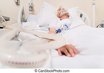 Ailing unstable woman breathing through special mask - High...