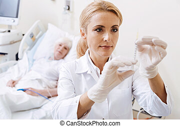 Thorough qualified doctor estimating the dosage