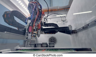 A low view on a circuit board coating machine. - A low angle...