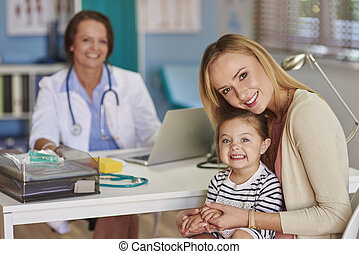 Mother and her daughter paying a visit at the doctor