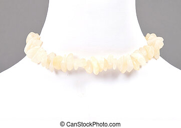 Splintered orange calcite chain on bust