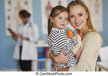 Portrait of mother and daughter at the doctor