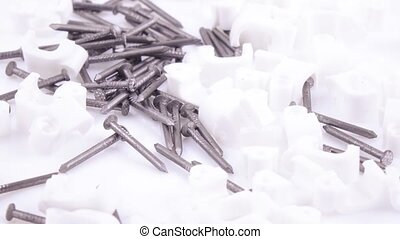 Stapling wiring and nails - White plastic staples with nails...