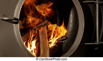 Fire wood burns in a fireplace