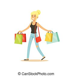 Happy blonde woman in a casual clothes walking with shopping...