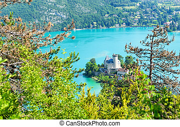 View of the Annecy lake with castle in the French Alps