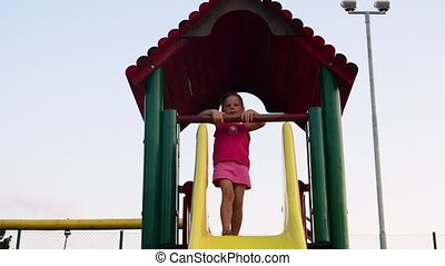 View of girl on slide at playground