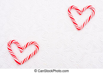 Candy Cane Heart - Two candy canes making a heart on a white...