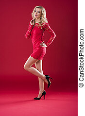 Woman with red dress and high heels