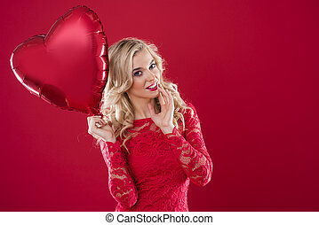 Charming woman with one heartshape balloon