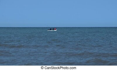 Fishing boat in the sea in the distance