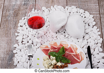Top view of a plate with prosciutto, Roquefort cheese,...
