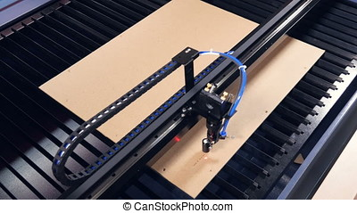 Laser cutting machine for wood working with plywood. 4K. -...