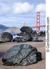 Baker Beach with the Golden Gate Bridge in the background. -...