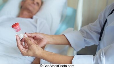 Close up of pills in hands of a professional doctor - Magic...