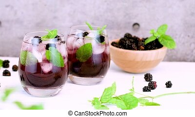 Fresh blackberry drink lime mint and ice
