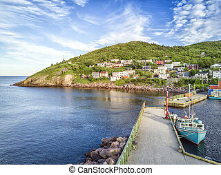 Petty Harbour with two piers during summer sunset,...